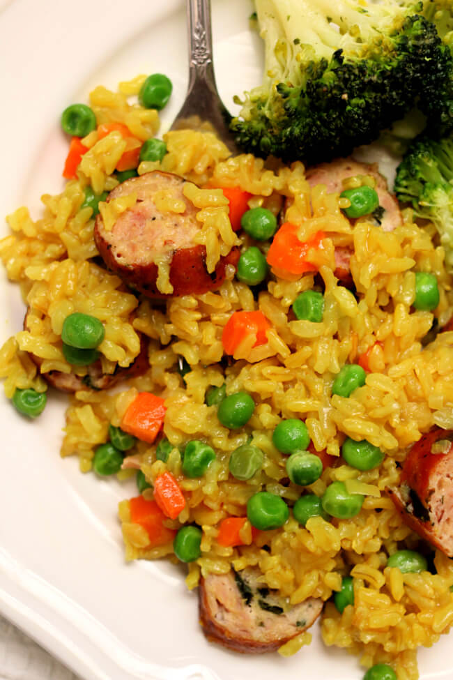 Instant Pot Brown Rice Pilaf with Chicken Sausage--a quick, easy and healthy meal of seasoned brown rice with carrots, peas and chicken sausage.
