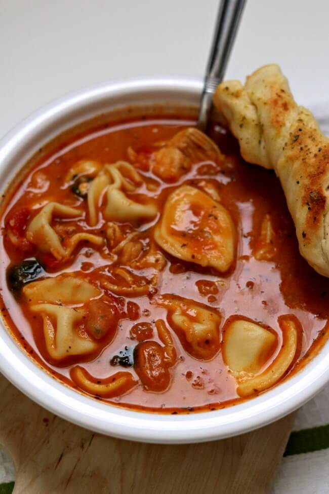 Slow Cooker Tuscan Tortellini Soup is a creamy tomato based soup with white beans, tortellini, spinach and tender bites of chicken. Take one bite of this soup and you'll quickly agree that this soup rocks the house.