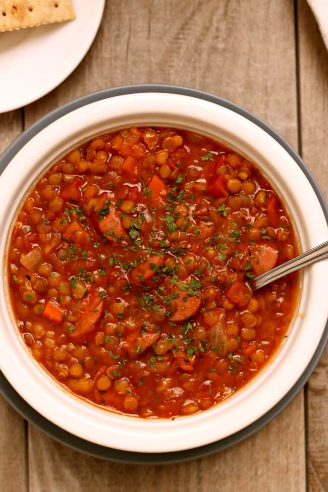 Instant Pot Lentil Stew--a comforting bowl of stew that can be make vegan or can be made with smoked sausage. Lentils cook so quickly in the electric pressure cooker! The leftovers make a great lunch the next day too.