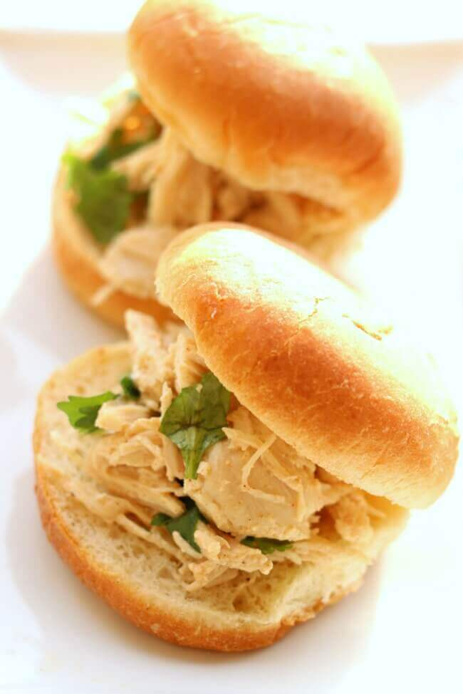 Slow Cooker Cilantro Lime Chicken Sliders--tender shredded chicken with lime and cilantro flavors served on a mini bun or roll. A super easy recipe that has loads of flavor.