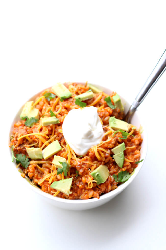 Instant Pot Salsa Rice--With just 5 ingredients and a few minutes you can make a delicious dinner that your family will love. A saucy, cheesy rice with browned sausage.