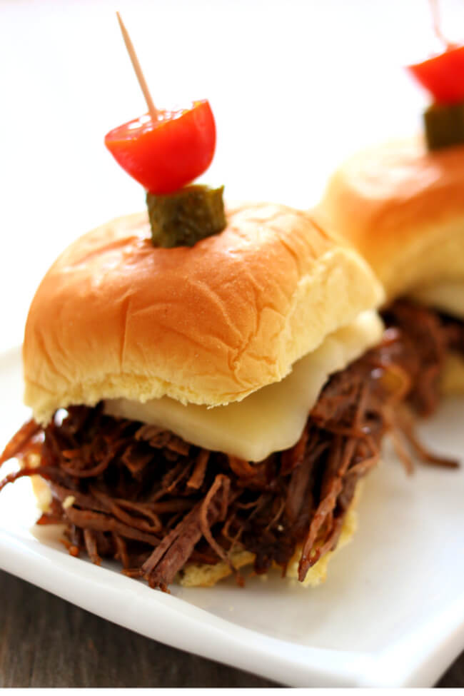 Instant Pot BBQ Brisket Sliders–tender and moist shredded or sliced beef brisket piled on a soft roll and topped with a slice of pepper jack cheese. A perfect recipe to make for game day.