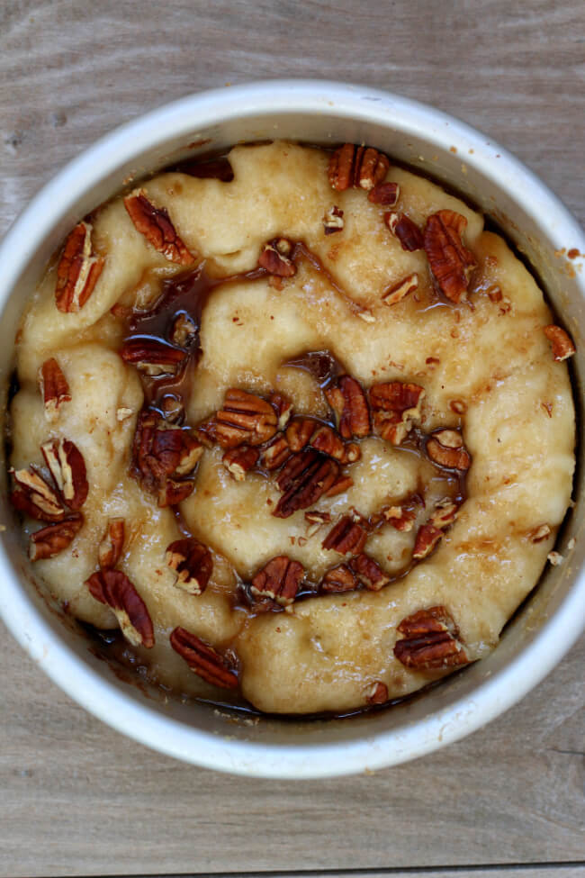 Instant Pot Praline Pecan Cobber--a gooey, caramelly praline pecan cobbler dessert that will blow your socks off. With a scoop of vanilla ice cream or whipped cream it tastes like heaven in your mouth.