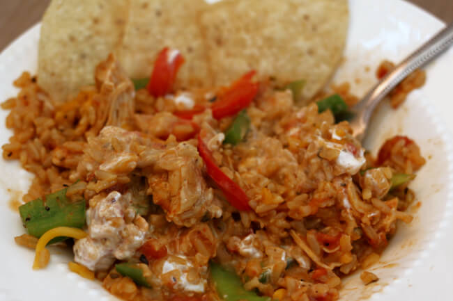 Instant Pot Chicken Fajita Rice--a throw everything into the Instant Pot and walk away meal! Flavorful rice and chicken that has all the great flavors from chicken fajitas! Make it with brown or white rice.