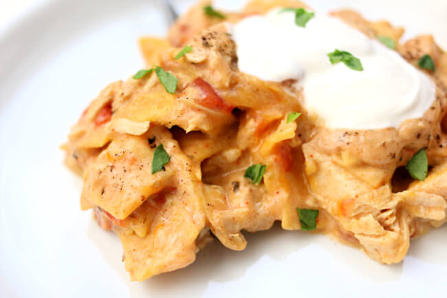Slow Cooker King Ranch Chicken--this cheesy and creamy chicken casserole with tortillas and Rotel has its roots in Texas but that doesn't mean us non-Texans can't enjoy it too! Whip up my version with your slow cooker and NO cream of soups!