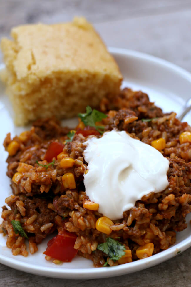 Cheesy, meaty and hearty this Instant Pot Cheesy Taco Rice has lots of flavor from corn, picante sauce, tomatoes, beef, brown rice and cheese. This recipe will quickly become a weeknight favorite.