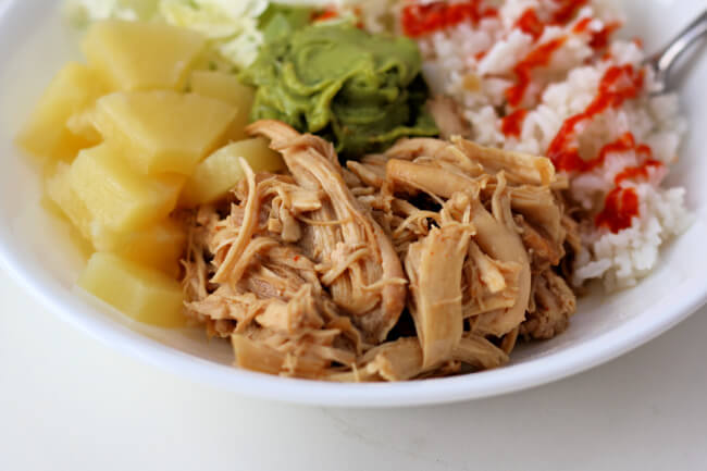 Slow Cooker Teriyaki Chicken--This easy chicken teriyaki recipe uses a homemade sauce made with pineapple juice, soy sauce, brown sugar, garlic and ginger. It has the perfect balance of sweet and savory. You can even use frozen chicken! Make it a meal by serving it with rice, pineapple chunks and shredded cabbage.