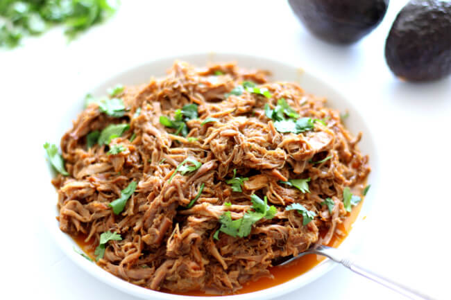 Instant Pot Cafe Rio Sweet Pork--make your favorite restaurant's sweet pork at home with just a handful of ingredients. This pulled pork is perfect over salad, rice, tacos, burritos, quesadillas or on a toasted bun.
