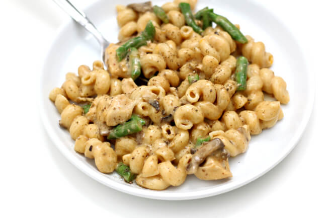 Instant Pot Cheesy Chicken Pasta--pasta, chicken, green beans and mushrooms are covered in a creamy, cheesy homemade sauce. An all-in-one-pot dinner that the whole family will love!