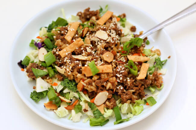 Instant Pot Egg Roll Bowls--The tastiest garlic sesame sauce coats ground beef (or ground chicken or turkey) and is tossed together with cabbage and fried wontons. This recipe is inspired by chinese egg rolls but it's given a fresher spin.