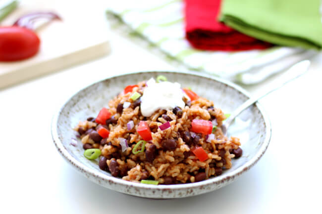 Slow Cooker Mexican Black Beans and Rice--This recipe for Slow Cooker Mexican Rice and Beans has become a staple at my house.  I love it because it's easy to get in the slow cooker within minutes and I love the creamy, yummy rice and beans that come out of the slow cooker a few hours later.