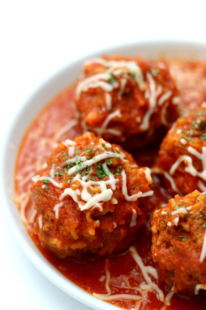 Instant Pot Porcupine Meatballs--a fun twist on a traditional meatball recipe. Uncooked rice is mixed with ground beef to make a meatball that looks like it has porcupine quills. My version is made quickly in the Instant Pot and served with an amazingly easy homemade marinara sauce.