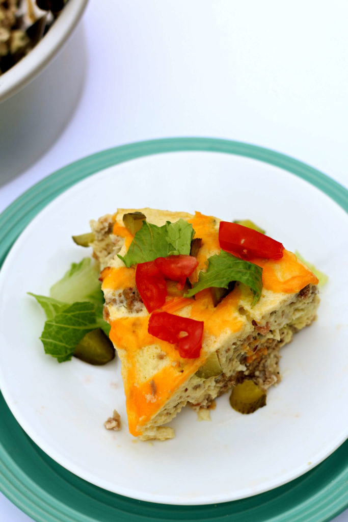 Instant Pot Cheeseburger Breakfast Casserole--a low carb egg dish that has bacon, beef, cheddar and pickles. This easy quiche-like dish is perfect for breakfast or dinner. It reminds of the Starbucks egg bites.