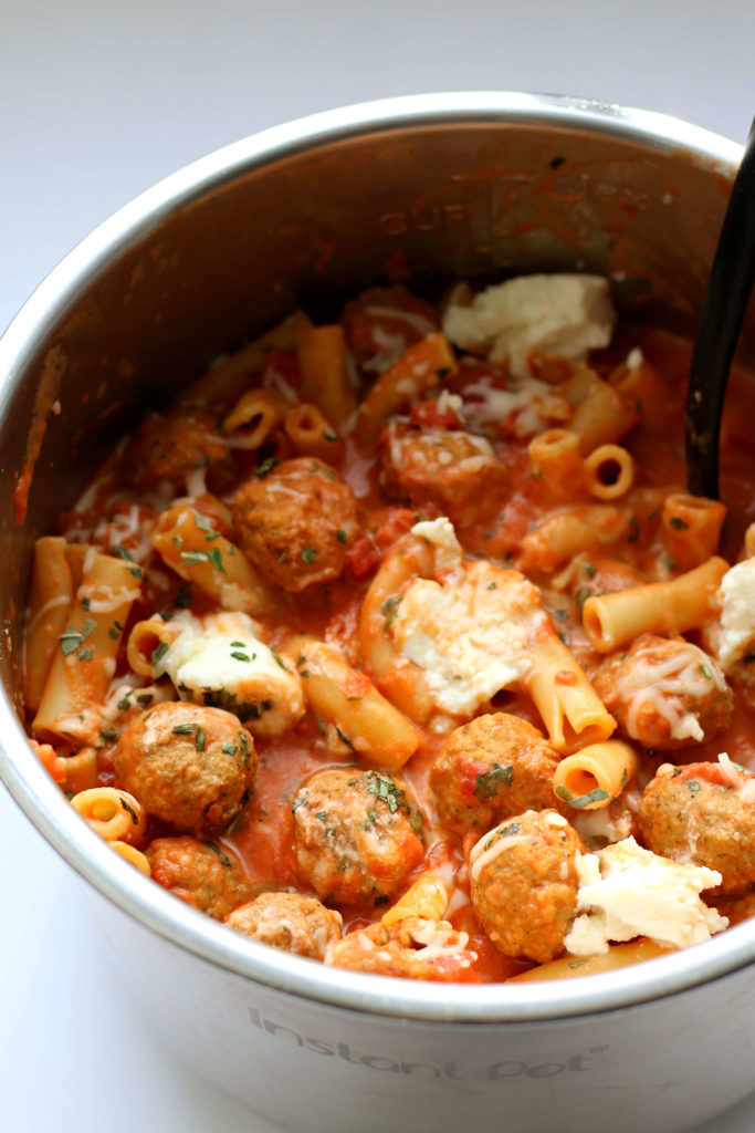 Instant Pot Ziti and Meatballs--an easy Instant Pot version of baked ziti with a scrumptious tomato cream sauce, ricotta and meatballs. Everyone will be asking for seconds!