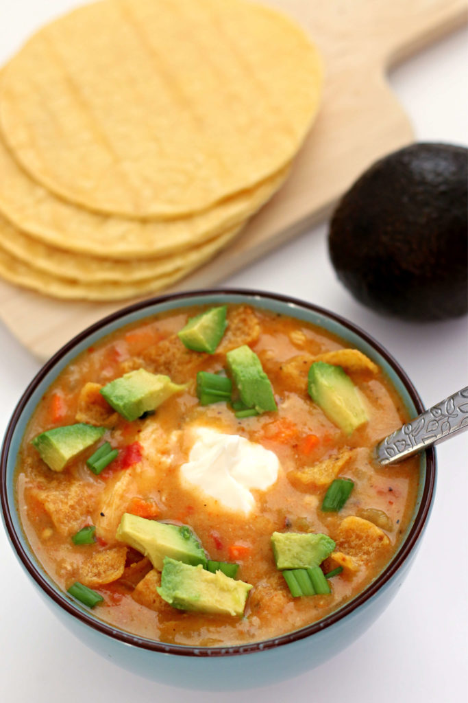 Instant Pot Chicken Tortilla Soup--tortilla soup that is made with actual tortillas! The corn tortillas pressure cook along with the bites of chicken, tomatoes, veggies and broth and then they thicken the soup into a lovely consistency. You're going to love this simple way to make real tortilla soup!