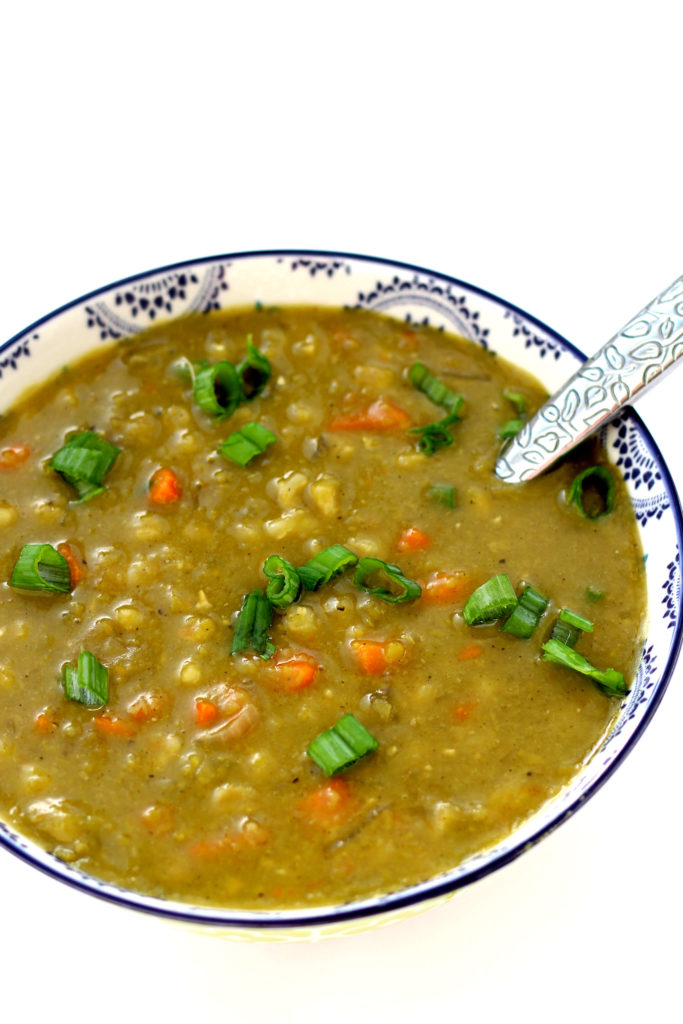 Slow Cooker Dakota Smashed Pea and Barley Soup--A hearty split pea soup with barley, carrots, onions, savory herbs and green onions. This is a copycat recipe of the popular vegan soup sold at California Pizza Kitchen.