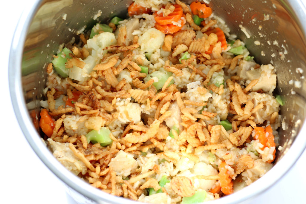 Instant Pot Zesty Chicken--an easy, flavorful casserole with rice, chicken, crispy fried onions and vegetables.