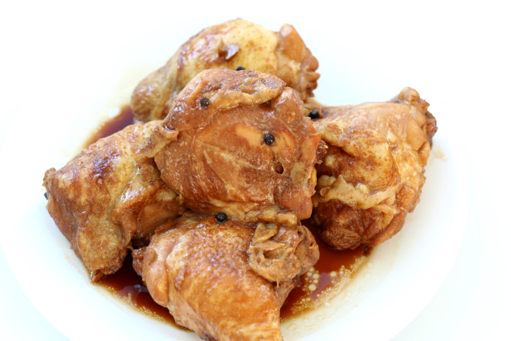 pieces of bone-in chicken on a white plate