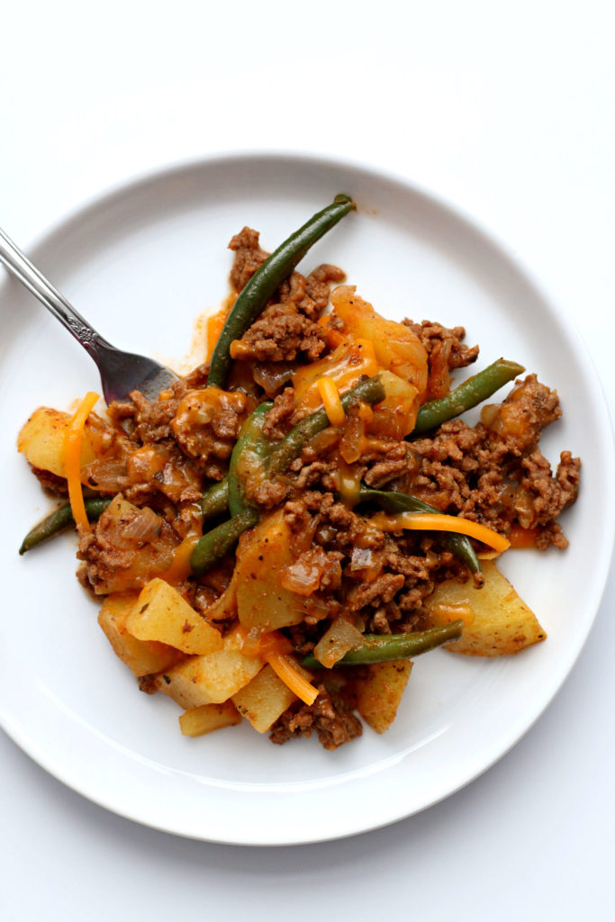 Instant Pot Shepherd's Pie Casserole--a beefy savory casserole with potatoes, green beans and cheddar cheese. The flavors from shepherd's pie made with a super easy, one-pot method.