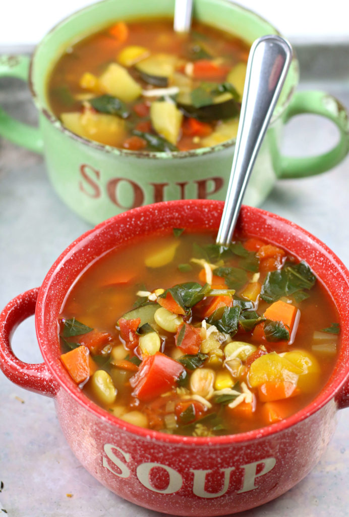 red and green soup bowls with vegetable soup