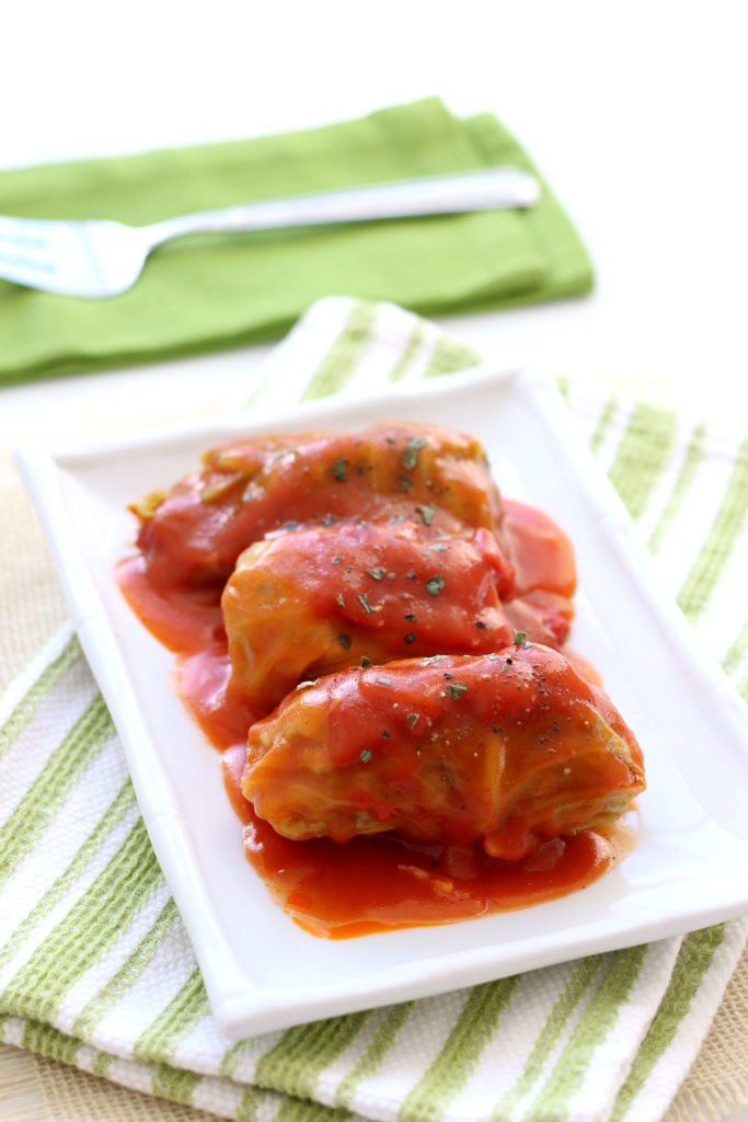 3 cabbage rolls on a white plate