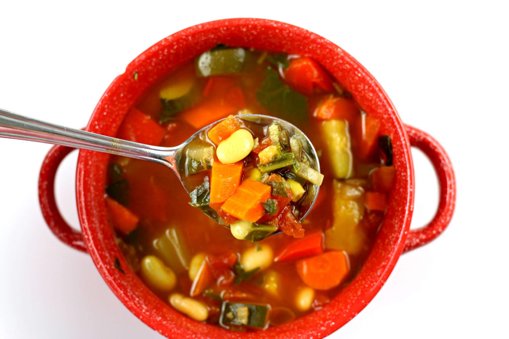 red bowl with vegetable soup