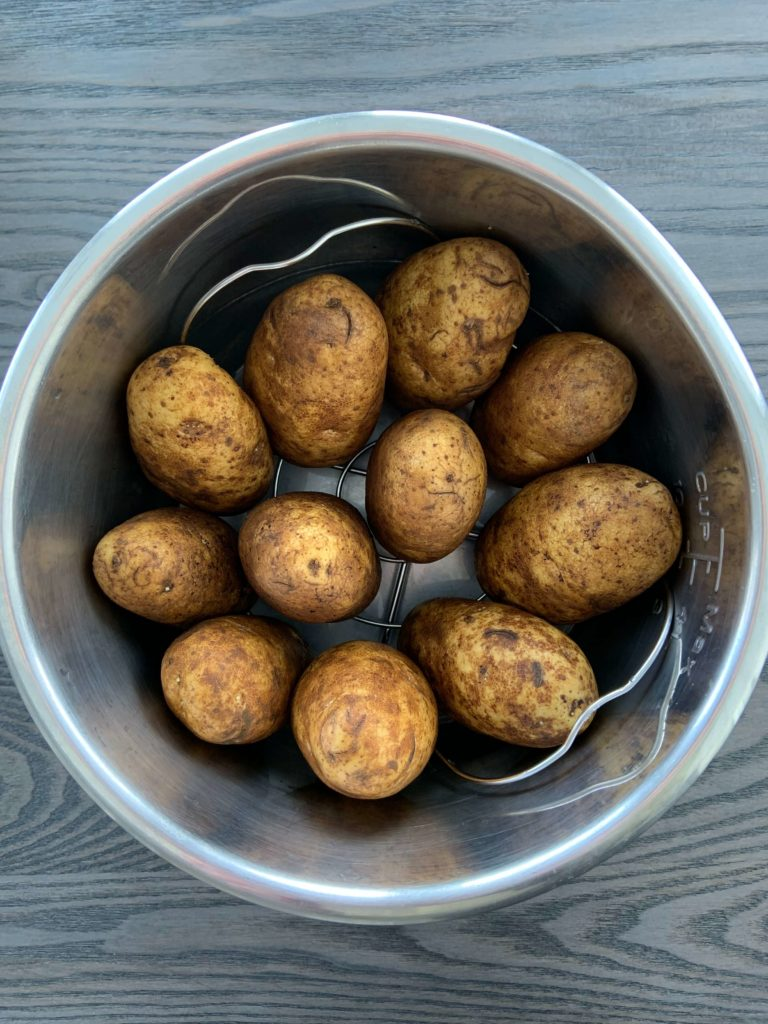 baked potatoes in an instant pot lined up vertically