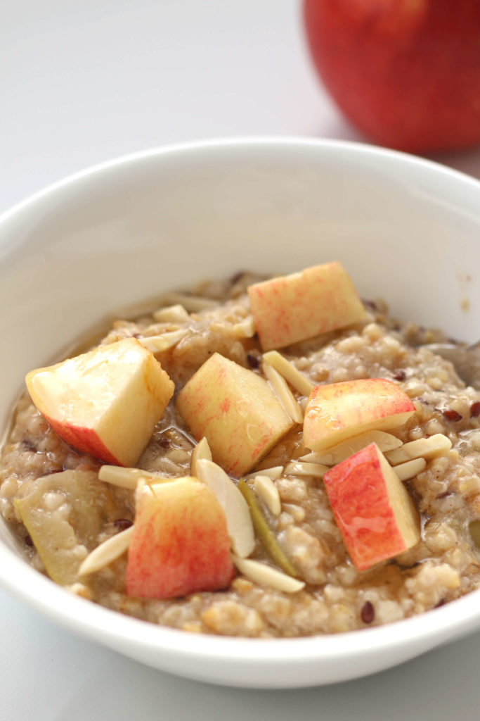 bowl of oatmeal with apples