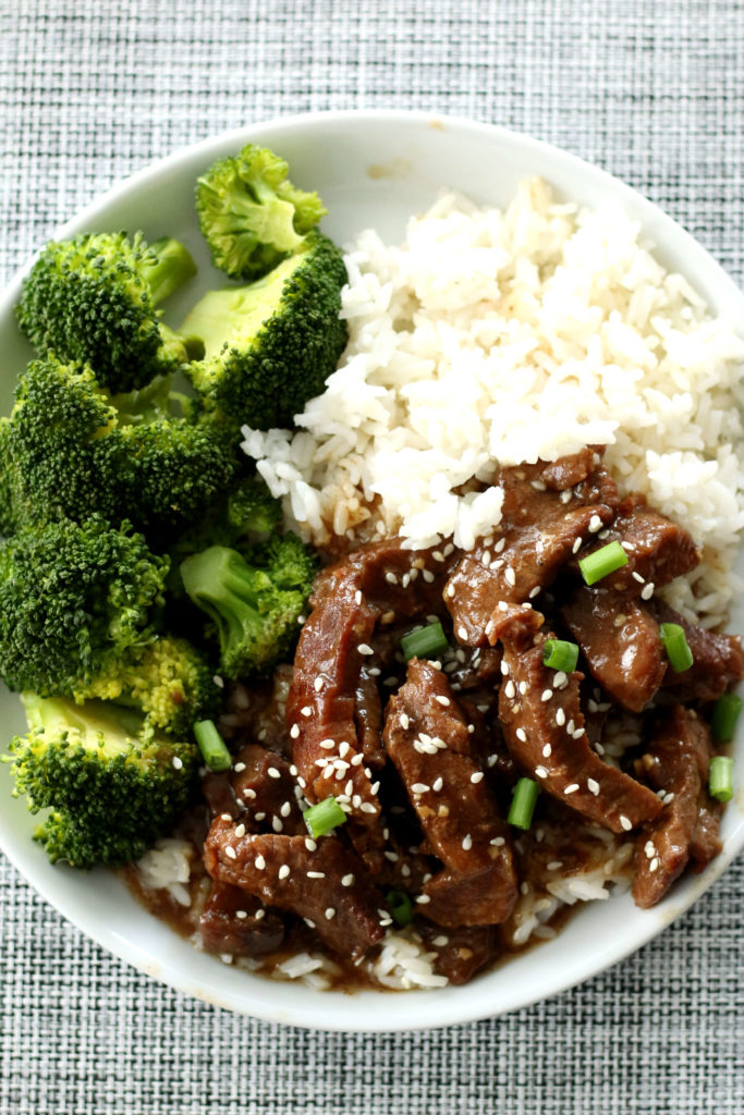 beef rice and broccoli on a plate
