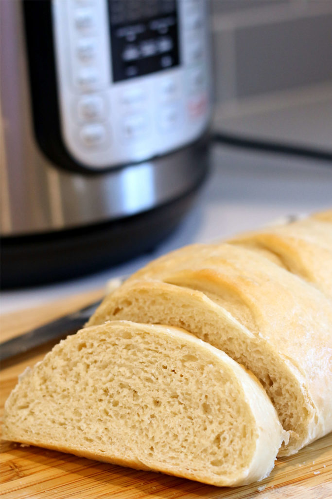 sliced french bread with instant pot in background