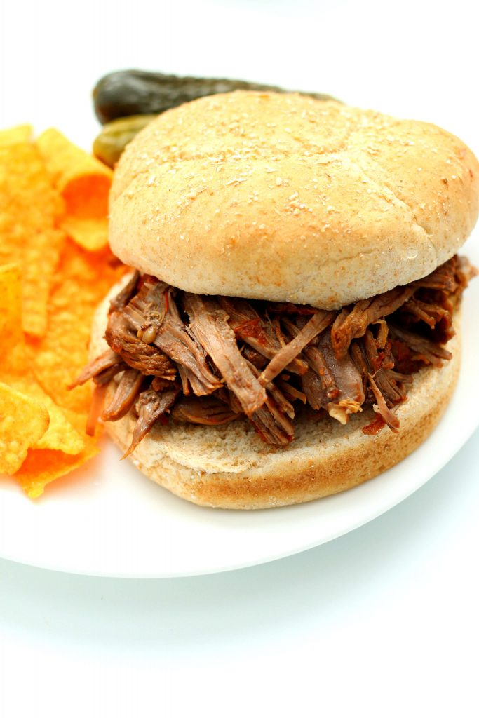 beef sandwich on a white plate