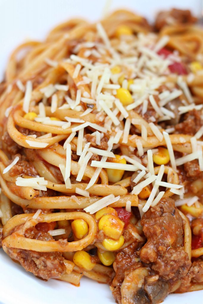 pasta dinner with parmesan cheese on top
